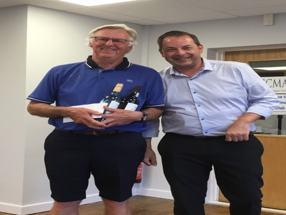 Brian Lever receives his prize for runner-up