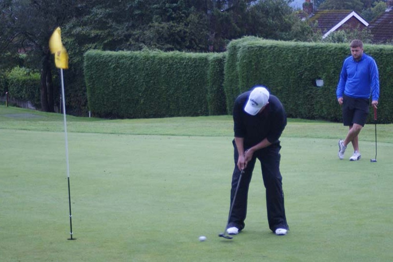 MDGA Captain Gary Brown putting on hole 9