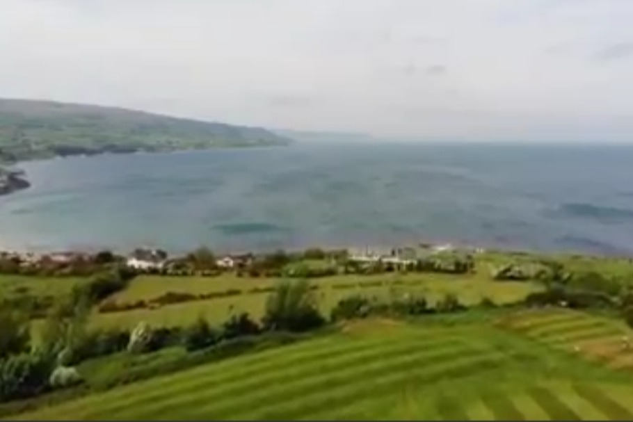 Ballygally Bay and the Antrim Coast from a drone