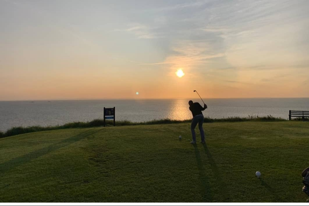 Sunrise tee shot on the 2nd, with Scotland in the background