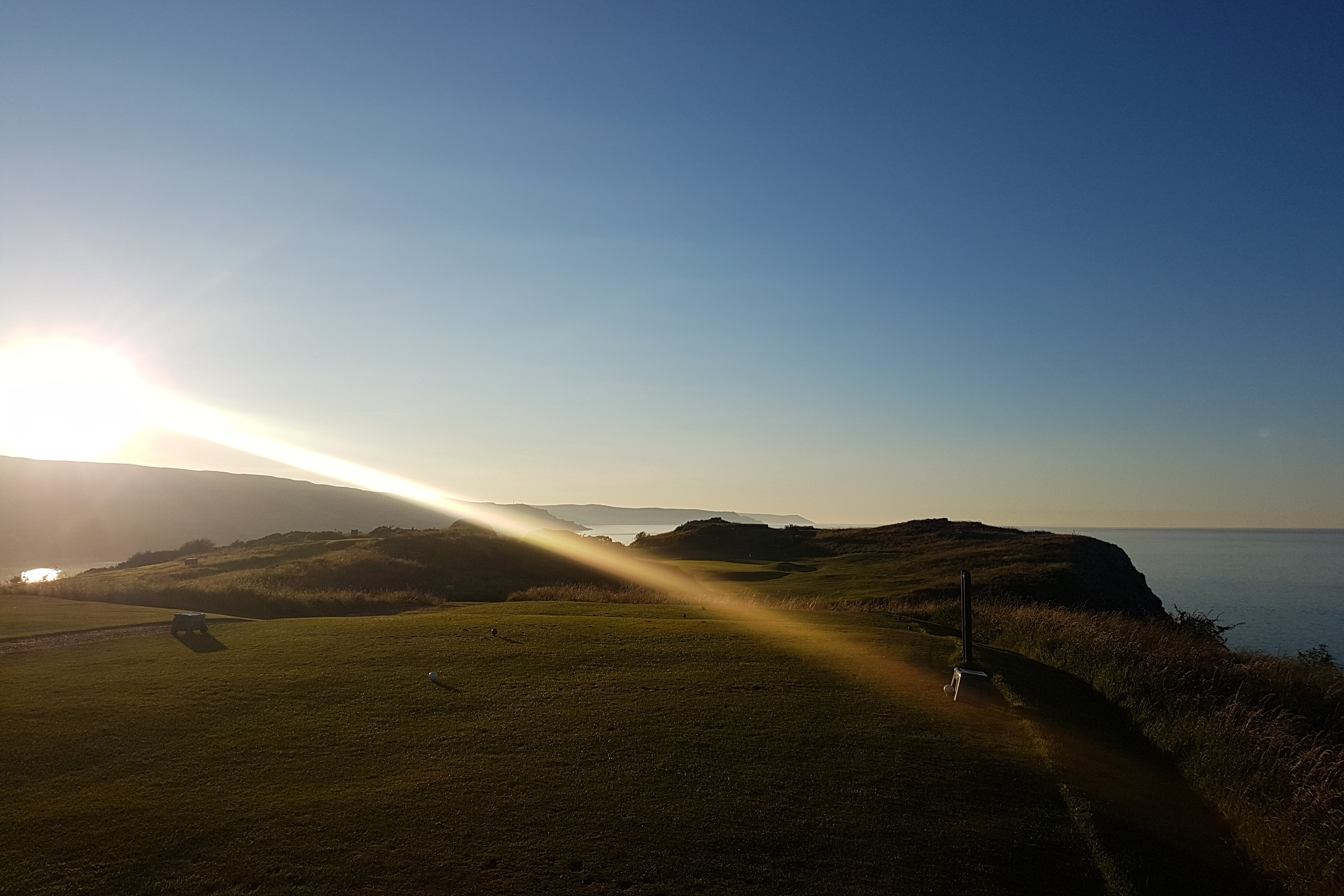 Sunset on the 2nd tee, with the Antrim Coast in the distance