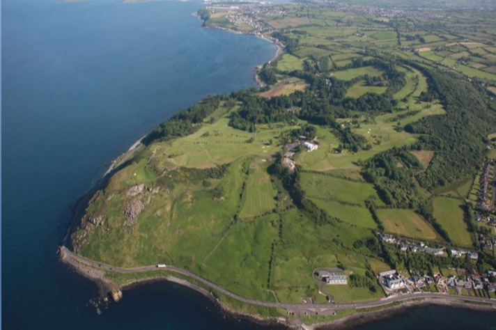 View of Ballygally Head with the 2nd and 3rd in the foreground, and Clubhouse to the middle right