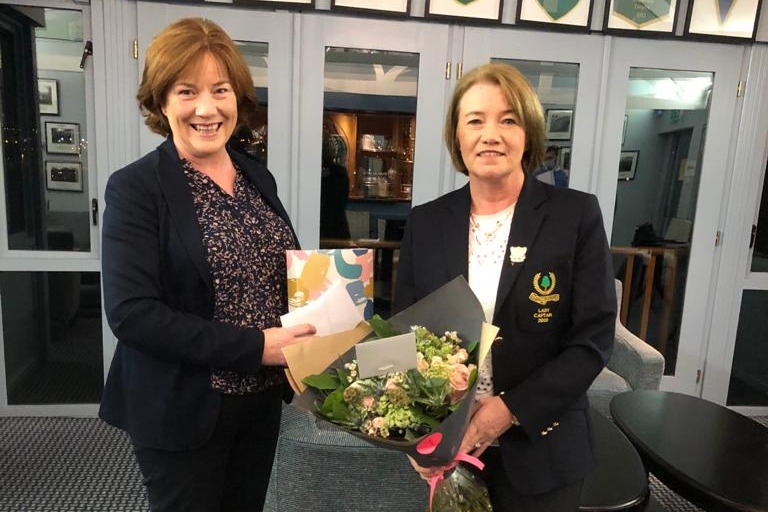 Lady Captain Alison presented with a gift from the Ladies Club